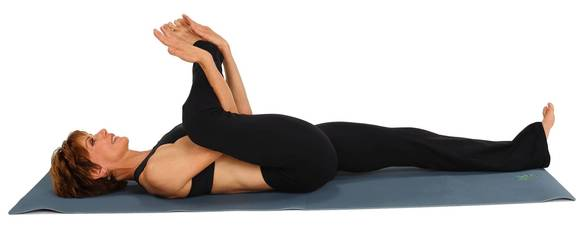 Bring your right leg towards you and wrap your right elbow (or wrist) under your right upper calf and your left elbow (or wrist) under your right ankle.