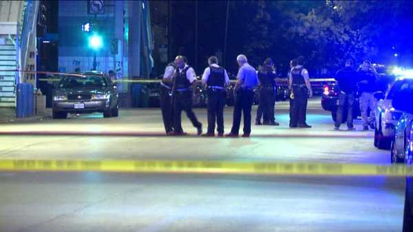 Chicago police on the scene of a shooting where a gunman fatally shot a man before opening fire on officers.