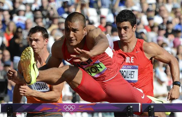 Ashton Eaton competes in his Men's Decathlon 110m hurdles heats at the London 2012 Olympic Games.