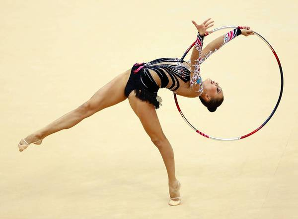 Kazakhstan's Anna Alyabyeva competes using the hoop in her individual All-around Gymnastics Rhythmic qualification match at the Wembley Arena during the London 2012 Olympic Games.