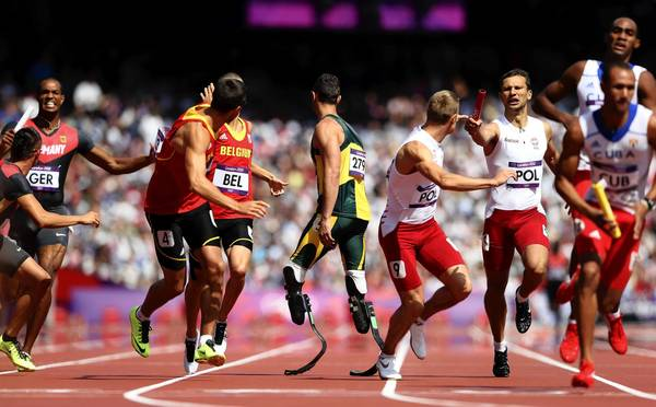 Oscar Pistorius of South Africa waits for the baton competes during the Men's 4 x 400m Relay Round 1 heats on Day 13 of the London 2012 Olympic Games.