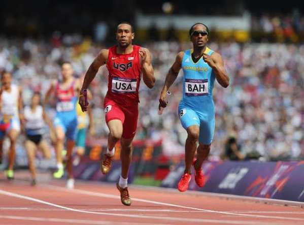 Bryshon Nellum, left, of the U.S. and Chris Brown of the Bahamas cross the finish line at the same time.