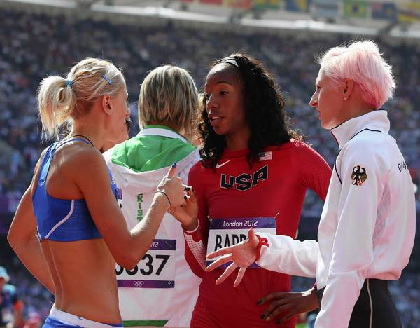 Adonia Steryiou of Greece, left, Brigetta Barrett of the United States and Ariane Friedrich of Germany talk with one another during the Women's High Jump qualification round on Day 13 of the London 2012 Olympic Games.