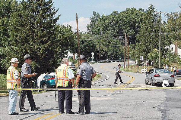 Police investigate a fatal crash July 29 , 2010, near the intersection of Mentzer Gap and Tomstown roads in Quincy Township, Pa. A 16-year-old Waynesboro, Pa., girl was killed.