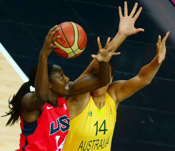 Australian center Elizabeth Cambage (R) challenges US centre Tina Charles during the London 2012 Olympic Games women's semifinal basketball match bewteen Australia and the US in London on August 9, 2012.
