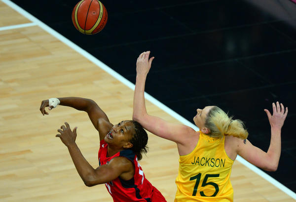 US forward Tamika Catchings (L) vies for the ball with Australian centre Lauren Jackson during the London 2012 Olympic Games women's semifinal basketball match bewteen Australia and the US in London