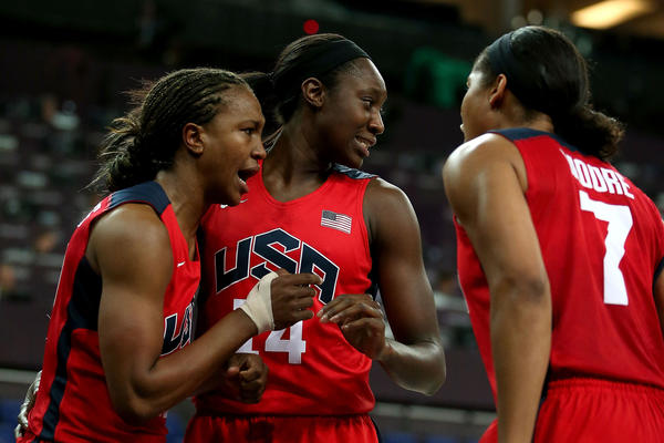 From left, Tamika Catchings #10, Tina Charles #14 and Maya Moore #7 of United States react in the first hal against Australia during the Women's Basketball semifinal on Day 13 of the London 2012 Olympics Games at North Greenwich Arena on August 9, 2012 in London,