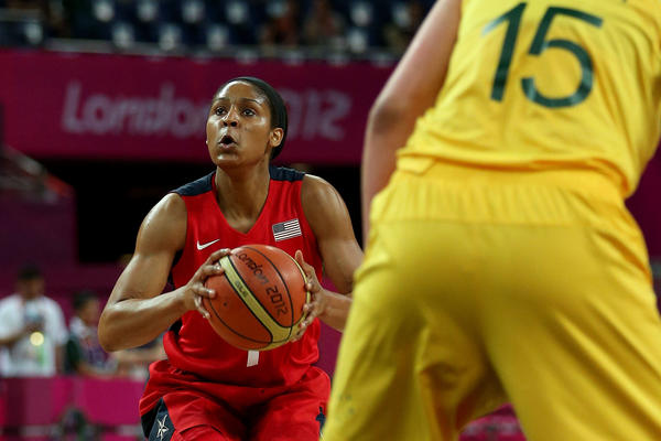 Maya Moore #7 of United States looks to move the ball in the first half against Lauren Jackson #15 of Australia during the Women's Basketball semifinal on Day 13 of the London 2012 Olympics Games at North Greenwich Arena on August 9, 2012 in London