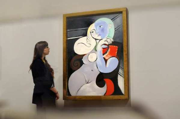 "Pablo Picasso's ""'Nude Woman in a Red Armchair."" An airport in Edinburgh, Scotland, has reversed its decision to cover up a poster of the painting."