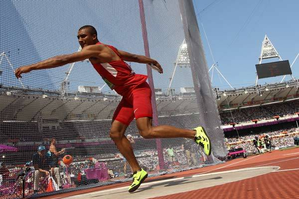 Ashton Eaton competes in the men's decathlon discus throw at the athletics event during the London 2012 Olympic Games.