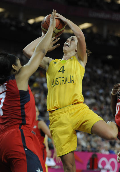 Australia guard Jenna O'Hea (4) shoots over USA forward Maya Moore (7)  during the women's semifinal during the London 2012 Olympic Games at North Greenwich Arena.