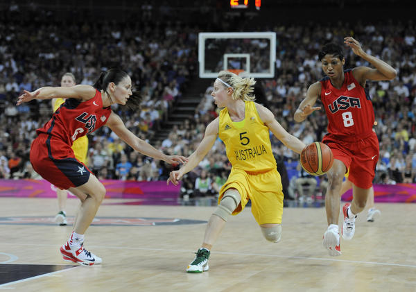 Australia's Samantha Richards (5) drives down court under pressure from USA guard Sue Bird (6) and forward Angel McCoughtry (8) during the women's semifinal during the London 2012 Olympic Games at North Greenwich Arena.