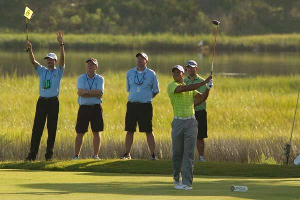 Tiger Woods looks on after teeing off on the tenth hole during the first round of the PGA Championship at The Ocean Course of the Kiawah Island Golf Resort.