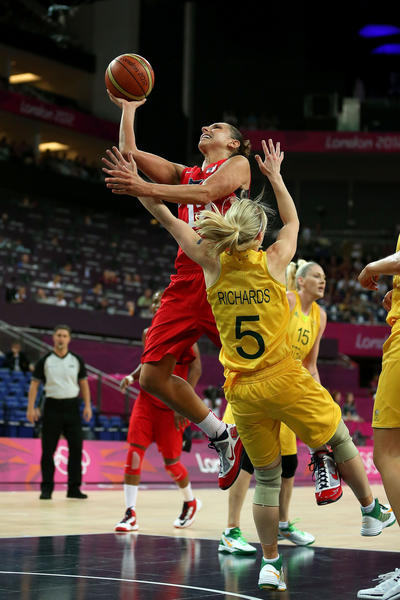 Diana Taurasi #12 of United States drives for a shot attempt in the first half against Samantha Richards #5 of Australia during the Women's Basketball semifinal on Day 13 of the London 2012 Olympics Games at North Greenwich Arena