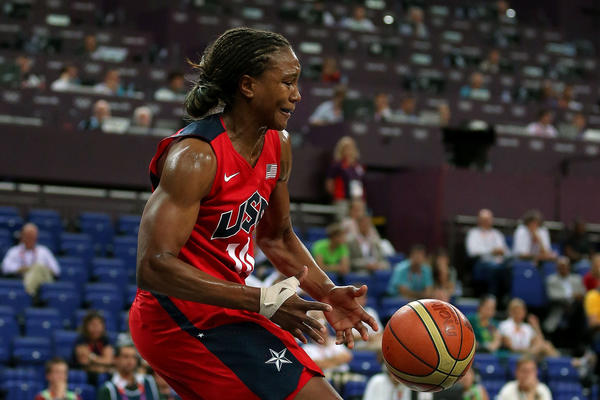 Tamika Catchings #10 of United States loses the ball in the first half against the Australia during the Women's Basketball semifinal on Day 13 of the London 2012 Olympics Games at North Greenwich Arena