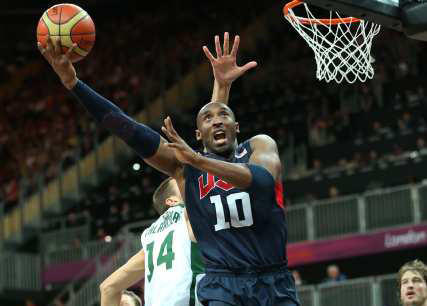 Team USA guard Kobe Bryant slips past Lithuania defender Jonas Valanciunas in the second half of a men's basketball prelim.