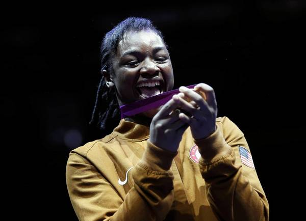 U.S. boxer Claressa Shields celebrates her gold medal during the presentation ceremony for the Women's Middleweight gold medal boxing match at the London Olympic Games.