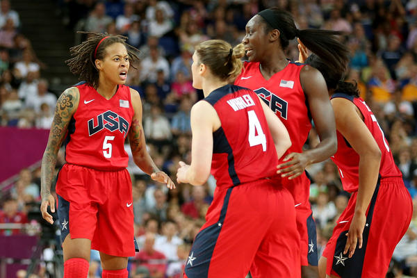 Seimone Augustus #5 of United States celebrates with teammates after scoring against Australia in the Women's Basketball semifinal on Day 13 of the London 2012 Olympics Games at North Greenwich Arena on August 9, 2012 in London,
