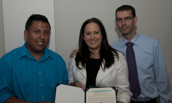From left: Rescuer Emmanuel Gonzalez, MWRD Commissioner Mariyana T. Spyropoulos holding the commendation resolution, and Andrew Pitts, who was pulled from the Chicago River.