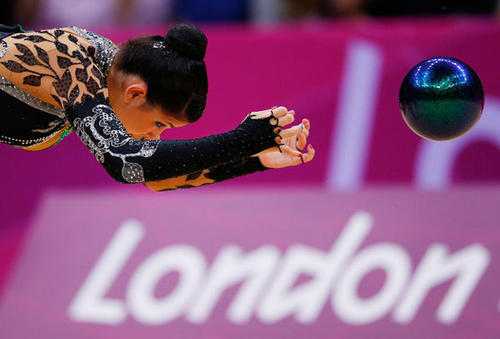 Julie Zetlin of the U.S. competes using the ball in her individual all-around gymnastics qualification match at Wembley Arena during the London 2012 Olympic Games August 9, 2012.