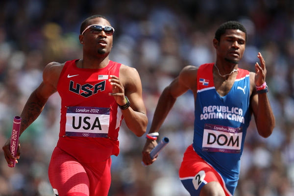 Manteo Mitchell of the United States and Gustavo Cuesta of Dominican Republic compete during the Men's 4 x 400m Relay Round 1 heats.