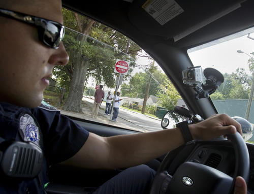 Newport News Police Officer Calvin Griffith rides through the south precinct during an evening shift on Wednesday, August 8.