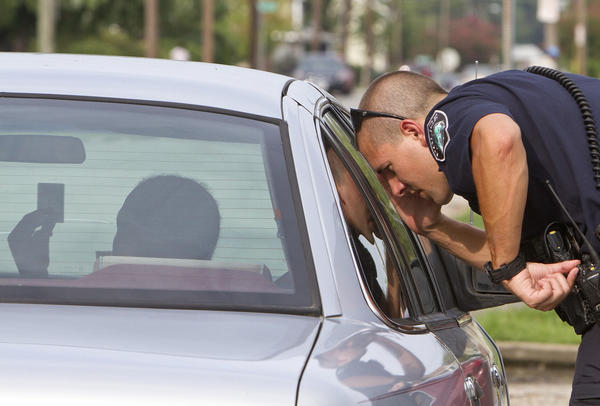 "Newport News Police Officer Calvin Griffith conducts a traffic stop in southeast Newport News on Wednesday, August 8. Griffith was one of several officers who rode along with a camera crew from COPS when the television show filmed Newport News police officers for eight months in July. Griffith said the show filmed mostly foot pursuits, narcotics and a couple of fights. ""I was actually pretty proud that they did come down here because it shows that we have enough exciting stuff happening down here,"" he said. ""I felt like it was cool because it kind of put us on the same level as a lot of the bigger agencies."""