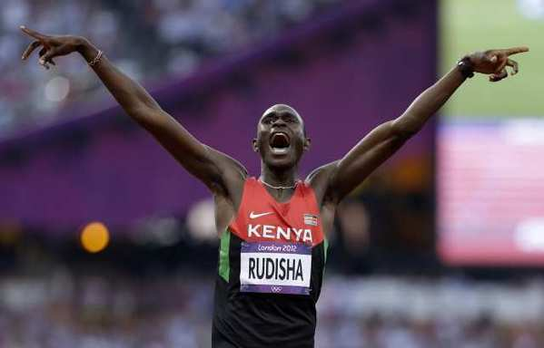 David Rudisha celebrates after setting a world record in the men's 800 meters.