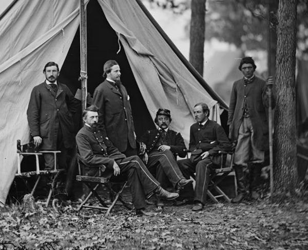 Army of the Potomac Medical Director Jonathan Letterman, shown seated at left, oversaw the evacuation of thousands of sick and wounded Union troops from their camps at Harrison's Landing in Charles City County to the growing hospital complex at Hampton.