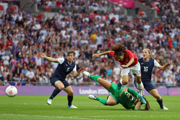 Yuki Ogimi #17 of Japan goes after the ball as she attempts to jump over goalkeeper Hope Solo #1 of United States in the first half during the Women's Football gold medal match on Day 13 of the London 2012 Olympic Games at Wembley Stadium on August 9, 2012 in London,