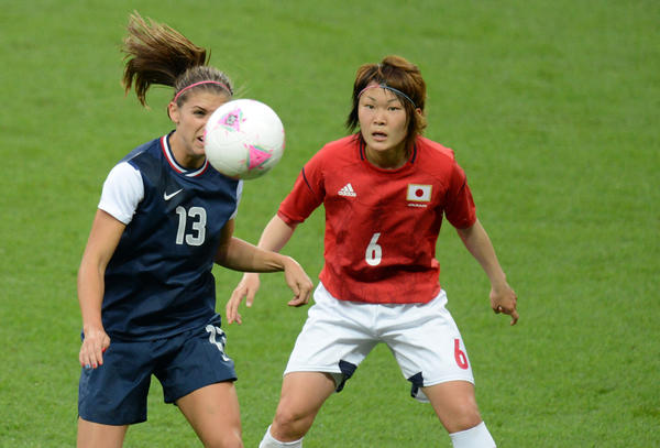 US forward Alex Morgan (13) and Japan midfielder Mizuho Sakaguchi (6) chase after the ball during the women's soccer gold medal match in the 2012 London Olympic Games at Wembley Stadium.