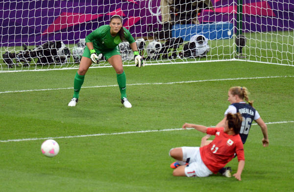 USA goalkeeper Hope Solo (1) watches as defenseman Rachel Buehler (16) tries to keep the ball away from Japan forward Shinobu Ohno (11) during the women's soccer gold medal match in the 2012 London Olympic Games at Wembley Stadium.