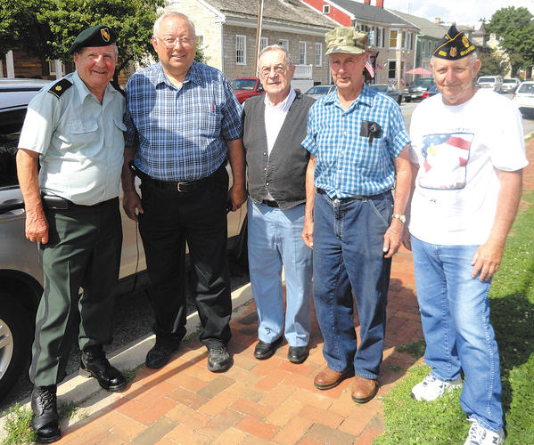 Several Sharpsburg residents initiated a project to place name signs above street signs to recognize Sharpsburg servicemen who were killed in wars. Those pictured include retired Maj. Dieter Protsch, Sharpsburg Mayor Hal Spielman, Peter Callas, Phil Stotelmyer and Lawrence Hoffman.