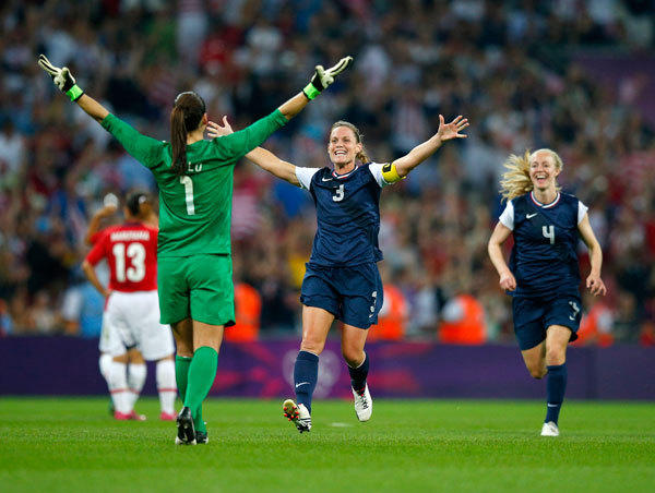 Goalkeeper Hope Solo of the U.S. celebrates with team mates Christie Rampone (C) and Becky Sauerbrunn (R) after they won their women's soccer final gold medal match against Japan at Wembley Stadium during the London 2012 Olympic Games August 9, 2012.