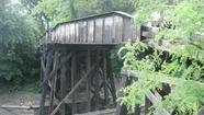 The pedestrian portion of a narrow 127-year-old steel-and-timber bridge in Hinsdale has been closed because of a structural crack.
