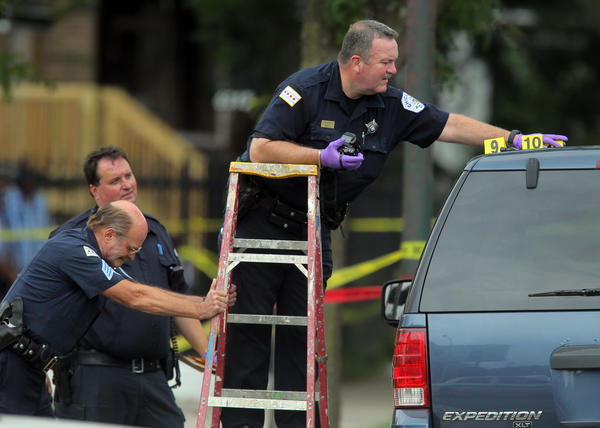Chicago Police work the scene of an officer-involved shooting near 63rd and Honore Streets in Chicago.