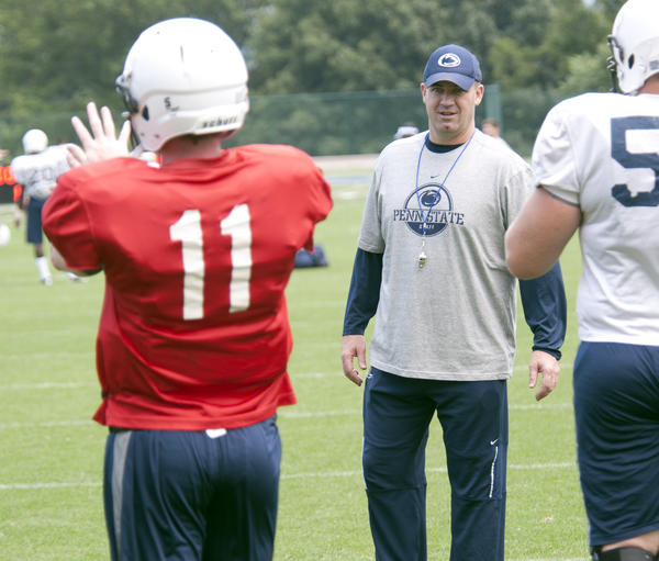 Penn State Nittany Lions head coach Bill O'Brien watches quarterback Matthew McGloin (11) as Penn State football holds is annual media day, in conjunction with that practice was open to the media for coverage.