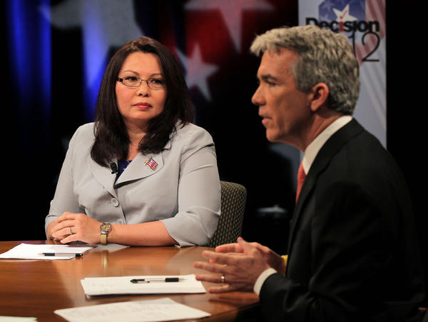 Democrat challenger Tammy Duckworth, left, and Republican U.S. Rep. Joe Walsh debate each other on May 11, 2012.