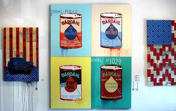 "Pieces by Electric Coffin, ""1960,"" left, and ""Bardahl Cans,"" center, are shown in the exhibit called ""The Garage"" at AR4T in Laguna Beach. Electric Coffin is work done by duo artists Patrick ""Duffy"" De Armas and Justin Kane Elder."