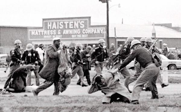 "Alabama state troopers swing nightsticks to break up the ""Bloody Sunday"" voting march in Selma, Ala., on March 7, 1965."