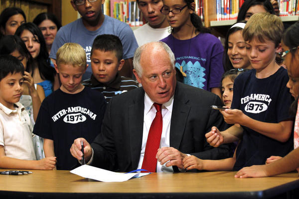 Gov. Pat Quinn signs a new law designed to strengthen bilingual education in Illinois, shown with students from Inter-American Magnet School in Chicago.