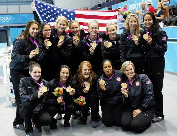 The U.S. Olympic women's water polo team shows off gold medals after beating Spain, 8-5, in London on Thursday. Laguna's Annika Dries is in the top row at the far left.