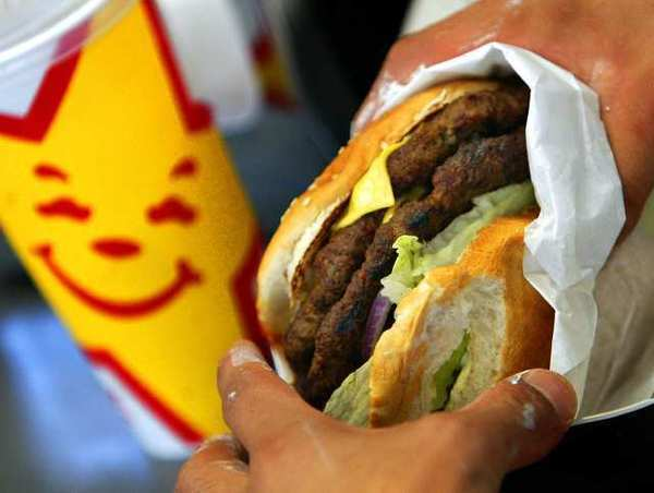 "Carl's Jr. owner CKE postponed its planned IPO because of ""market conditions."""
