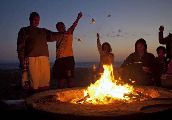 Members of the Sasser-Williams family roast marshmallows as they gather around a bonfire at Dockweiler Beach in Playa del Rey. Of the 108 state parks and beaches in California, only 24 allow fires, and some have early curfews.