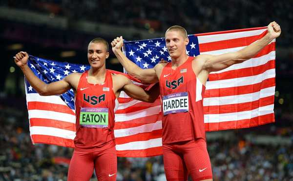 Gold medal winner Ashton Eaton, left, and silver medalist Trey Hardee, both of the United States, hold up the American flag after winning the men's decathlon competition.