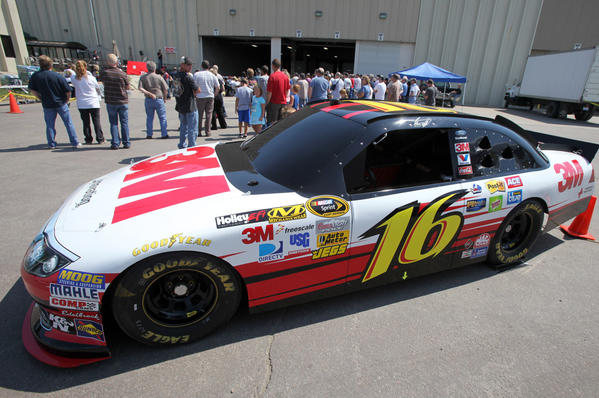 A replica of NASCAR driver Greg Biffle's 16 car, outfitted with driver simulation systems, was on display during a visit by Biffle to the Aberdeen 3M plant Thursday. photo by john davis taken 8/9/2012