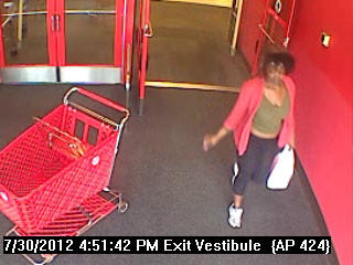 A surveillance photo at Target entrance of possible suspect in use of stolen credit card.