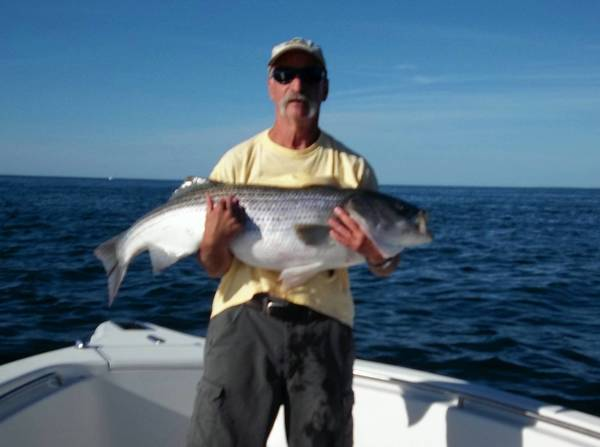 Ed Watro of Allentown shows of the 38-pound striped bass he caught in the Atlantic Ocean off Montauk Point fishing on the Mountain Dew charter with Captain Emil Caiazza on July 25, 2012.