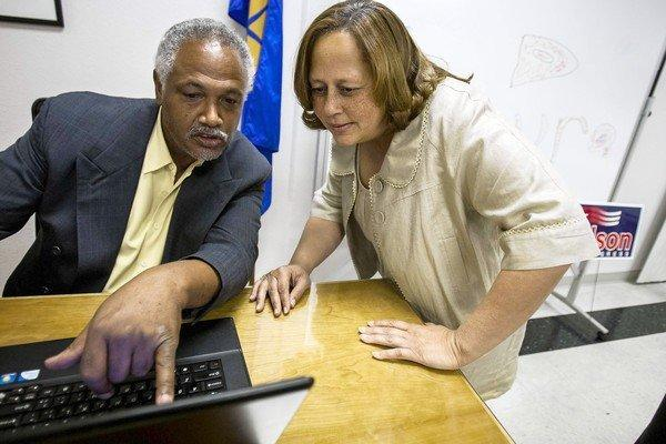 Rep. Laura Richardson, right, and a campaign volunteer review incoming results during the June primary. Despite her House reprimand for misusing government resources by illegally requiring her congressional staff to do campaign work, some election watchers refuse to count her out of the fall race.