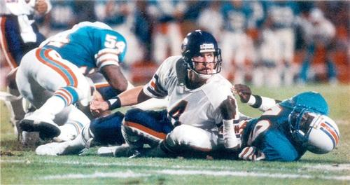 Quarterback Steve Fuller, in for Jim McMahon, watches the Bears' perfect season slip away in a loss to the Dolphins.